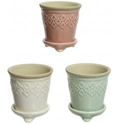 A charming assortment of pastel toned planters, set with a matching footed plate and added crackle effect glaze
