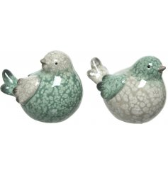 A cute assortment of green and mink toned terracotta birdies