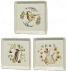 A beautiful assortment of finely detailed porcelain plates, delicately finished with a Vintage Easter inspired decal