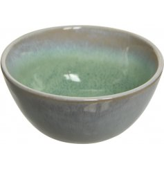 A charming stoneware bowl with a rich green ombre glaze in the middle.