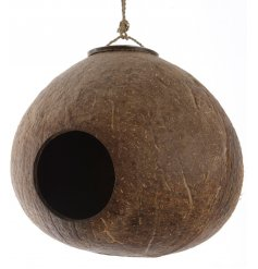 Bring a trendy touch to your garden space with this shaved coconut bird house