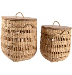 A beautiful set of sized storage baskets, complete with natural wooden lids.
