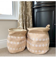 A set of 2 round storage baskets, complete with a natural stitched design and diamond pattern