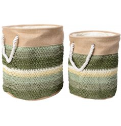 A set of 2 round storage baskets, complete with an Earthen inspired tone and woven pattern decal