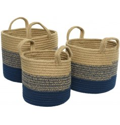 A set of 3 rustic style jute baskets with handles. Each has a rustic navy and natural woven design.