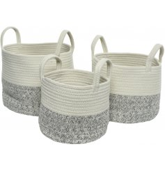 A set of 3 chic and classic woven baskets made from white and grey wool.