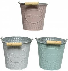 A mix of 3 iron buckets in pretty pastel colours. Each is embossed with a home label and is complete with wooden handle.