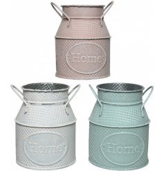 A mix of 3 iron churn planters in pretty pastel colours. Each has an embossed Home label and a textured surface pattern