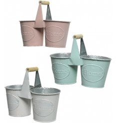 An assortment of 3 metal buckets in pretty pastel colours. Each has a textured finish and a Home embossment.