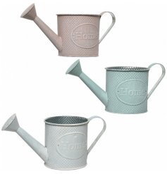 A mix of 3 pretty pastel watering cans with a textured dot finish and Home embossment.