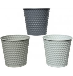 A simple and stylish assortment of iron planters set with an embossed dot decal and matt colour finish