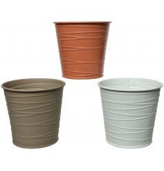 An assortment of 3 metal planters, each set with an embossed line decal and matte colour