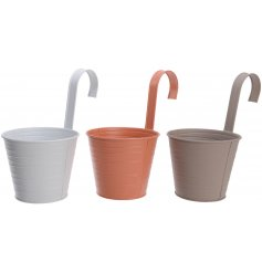 An assortment of 3 metal hanging planters, each set with an embossed line decal and matte colour
