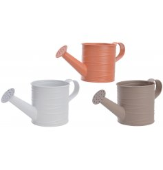 An assortment of 3 metal watering can planters, each set with an embossed line decal and matte colour