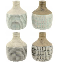 A mix of 4 natural terracotta vases with a blue and grey glaze finish. Each has an intricate repeat pattern.