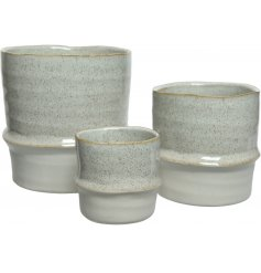 A set of 3 beautiful natural stoneware planters with a rich cream speckled glaze.