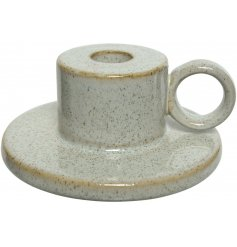 A beautiful stoneware candle holder with a cream natural glaze. A charming decoration for the home.