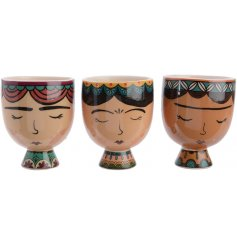 A mix of 3 stylish and unique women planters in colourful and decorative designs.