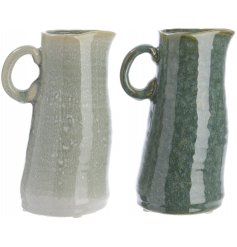 An assortment of 2 crafted ceramic jugs with a rich green glaze.