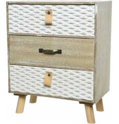A stylish shabby chic cabinet with three drawers. Each has a white washed finish and a rustic design.
