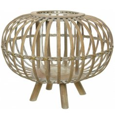 A unique hurricane lantern on foot. This contemporary bamboo design has a white washed finish.