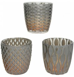 A stylish assortment of glass tlight holders, individually designed with a golden ombre effect and embossed decal