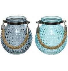 an assortment of 2 candle holders, decorated with coastal blue tones and a ridge effect