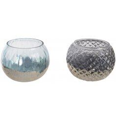 Bring a touch of Luxe to your home interior with this stylish assortment of round glass candle holders