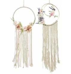 An assortment of 2 beautiful macrame style wall hangings with textured ribbon and artificial flowers