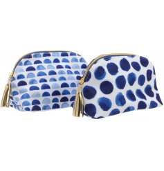 A mix of 2 blue patterned wash bag with gold tassel.
