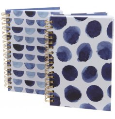 An assortment of 2 chic notebooks with lined paper.