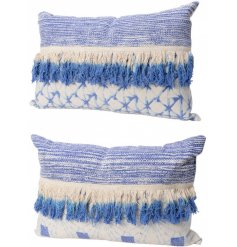 An assortment of 2 blue tassel cushions with a chic tie dye design.