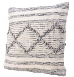 A chic cotton cushion with a woven pattern in blue, yellow and natural threads.