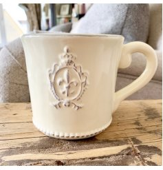 A beautifully smooth glaze finished ceramic cup, complete with a embossed Fleur De Lis