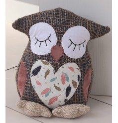 An Owl doorstop set with a Tweed effect and added coloured feather decal
