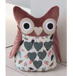 A charming Owl doorstop, beautifully decorated with a pink velvet fabric and added feather decal