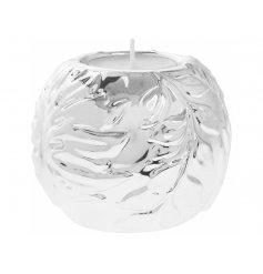 An attractive silver sphere t-light holder with a decorative leaf pattern. Part of our luxury living range.