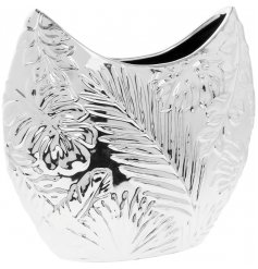 An artistic leaf design vase with a shiny silver finish and leaf design print.