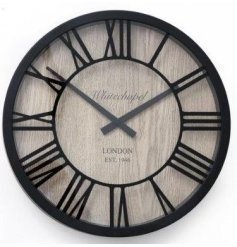 A contemporary inspired wall clock. Set with a black frame effect and natural wood decal