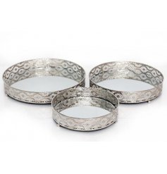 A set of 3 attractive silver candle plates with a mirrored base. A beautifully intricate design and stylish accessory.