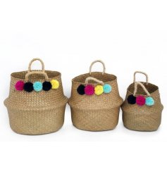 Bring some colour to your home with this chic set of sized woven baskets