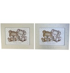 Two assorted silver photo frames in and brother\sister and me design