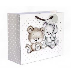 Wrap your gifts with love with this adorable natural gift bag with a cute bunny and bear design.