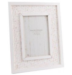 "With its distressed features and 4x6"" picture space, this charming frame will fit in with any themed home interior"