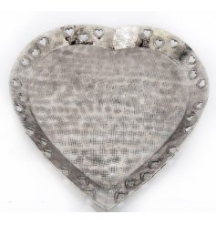 A rough finished and distressed silver set heart shaped bowl, decorated with additional heart edges