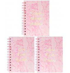 A sleek and stylish assortment of pink marble printed hardback notebooks, each set with its own golden embossed text