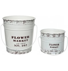 A set of 2 shabby chic style buckets with a distressed Flower Market design.