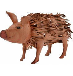 Bring a charming touch to your garden space with this sweet standing metal pig