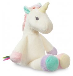 A super soft and snuggly soft toy in a cream tone with an added rainbow ribbon decal and sweet pastel toned accents
