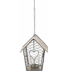 this charming tlight hanging decoration is perfect for bringing a warm glow to any space its in